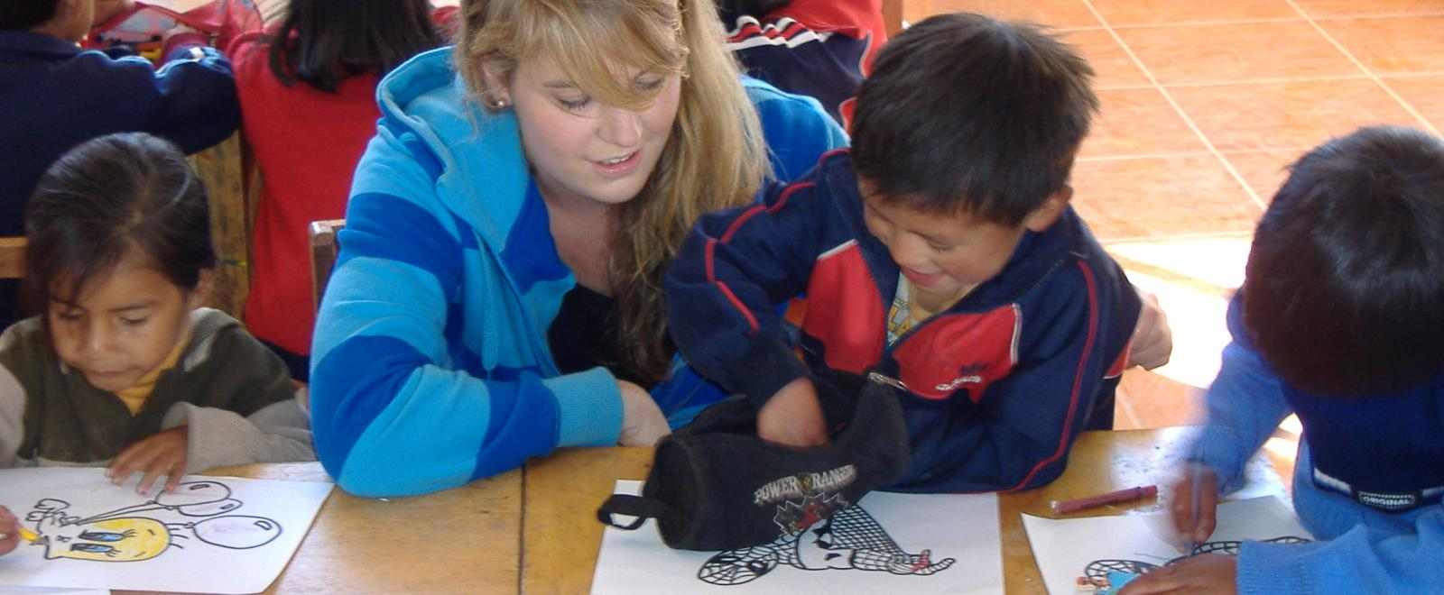 Projects Abroad volunteer works with children on the Peru Childhood Development Project